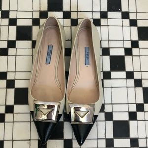 Used off white and black Prada flats